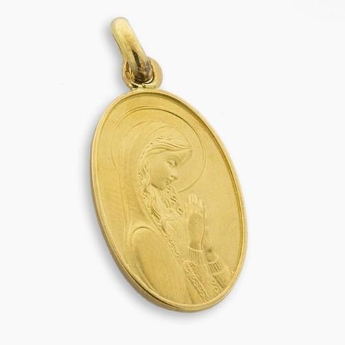 Medalla de oro macizo en forma oval